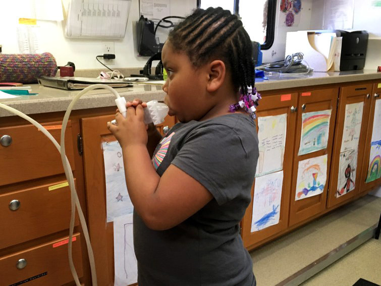A lung test on the Breathmobile finds that 5-year-old Brooklyn Turner's pulmonary function is compromised by her asthma.